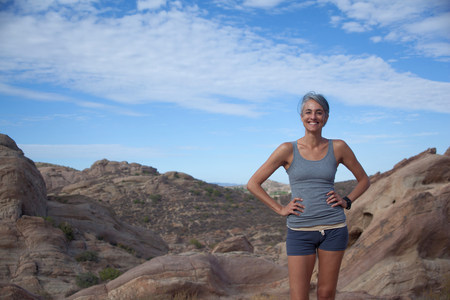 Woman standing at Vazquez Rocks with hands on hips LANG_EVOIMAGES
