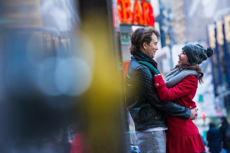 Young tourist couple hugging, New York City, USA