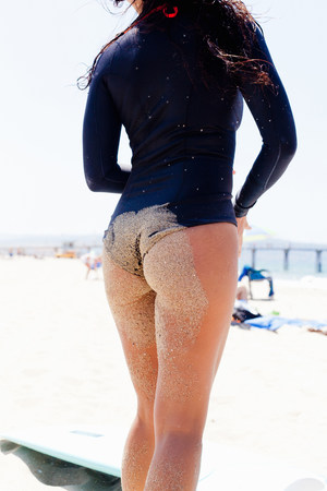 Close up of female surfer,Hermosa Beach,California,USA