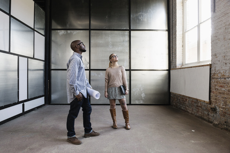 two persons only: Young business partners looking at new office space LANG_EVOIMAGES