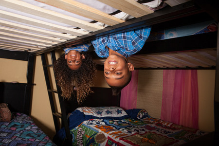 bunkbed: Two brothers leaning over bunkbed