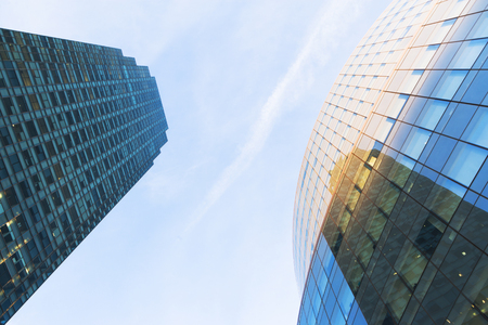 mirroring: Close up angled view of two skyscrapers,New York City,USA LANG_EVOIMAGES