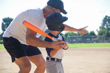 strips away: Man teaching grandson to play baseball