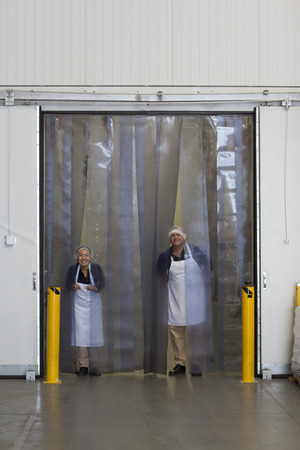 refrigerator: Factory workers by distribution warehouse loading bay