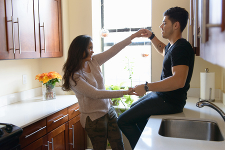 worktops: Young couple holding hands in kitchen