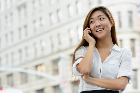 Business woman on mobile phone looking sideways