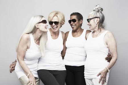 60 64 years: Studio portrait of senior women friends having fun