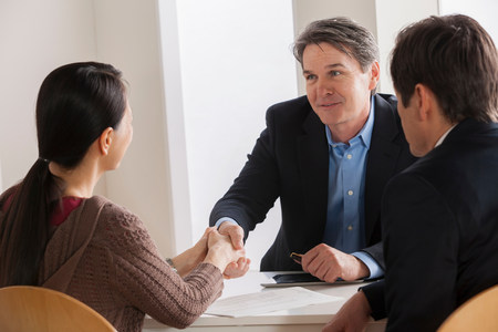 Mature couple meeting businessman