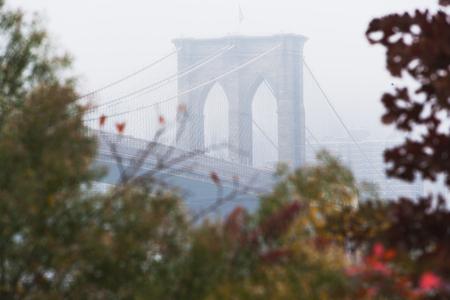 tallness: Detail of Brooklyn Bridge in mist,New York City,USA