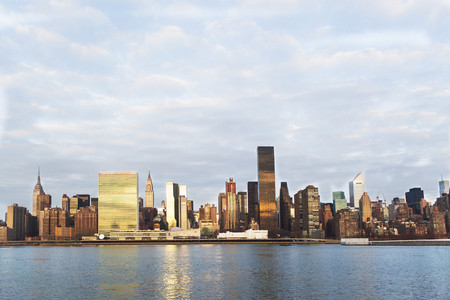 mirroring: View of East River and manhattan skyline,New York,USA