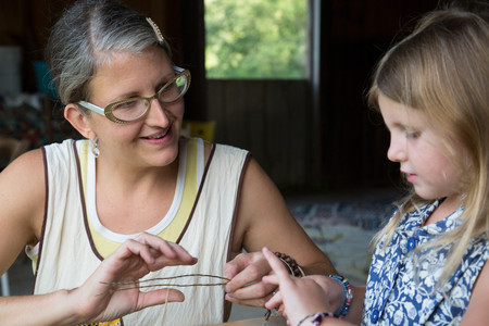 farmyards: Mother and daughter selecting dried herbs LANG_EVOIMAGES