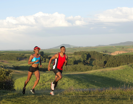 Young couple jogging in landscape,Othello,Washington,USA