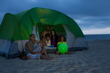 Family with four children in tent on Huntington Beach,California,USA