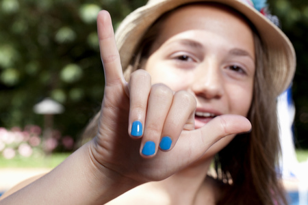 chillout: Girl with painted finger nails LANG_EVOIMAGES