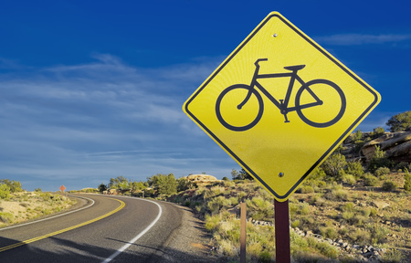 one lane road sign: Yellow bicycle crossing sign, Canyonlands National Park, Utah, USA