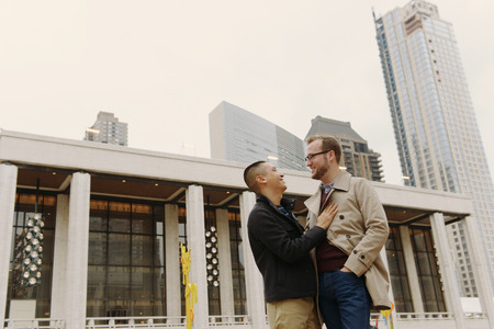 state of mood: Gay couple chatting,Lincoln Center,Manhattan,New York LANG_EVOIMAGES