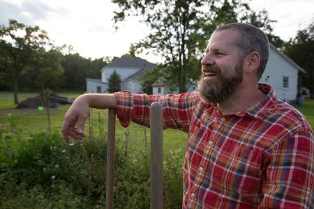 self sufficient: Portrait of mature man on herb farm LANG_EVOIMAGES