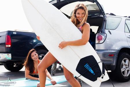 Female friends with surf boards,Hermosa Beach,California,USA