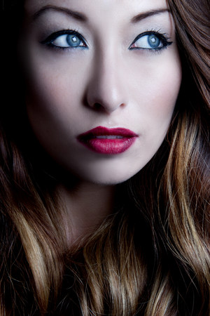 Portrait of brunette woman looking sideways