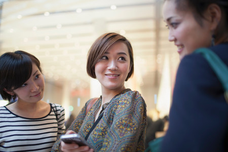 Three young Japanese women talking