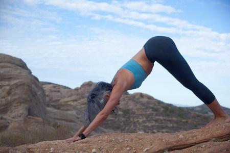 Woman doing yoga at Vazquez Rocks
