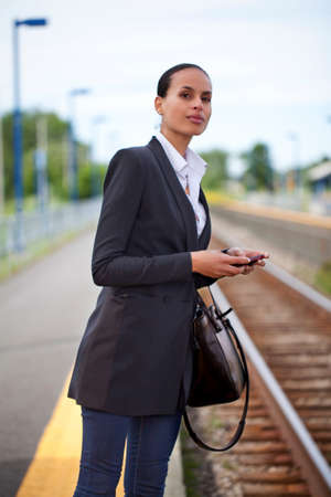 Businesswoman waiting on railway platform