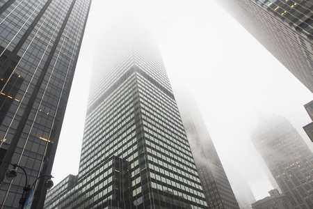 tallness: View of skyscrapers in mist,New York City,USA