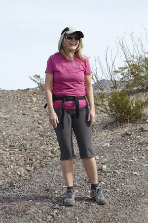 Portrait of senior female hiker on arid hill
