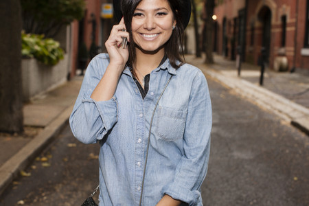 headshots: Woman talking on cellular phone