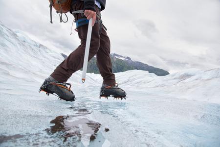 crampon: Young man walking on Mendenhall Glacier,Alaska,USA LANG_EVOIMAGES