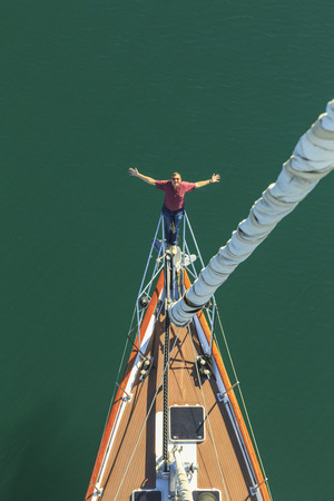 Senior man seen sailing from above with arms outstretched, San Diego, California, USA LANG_EVOIMAGES