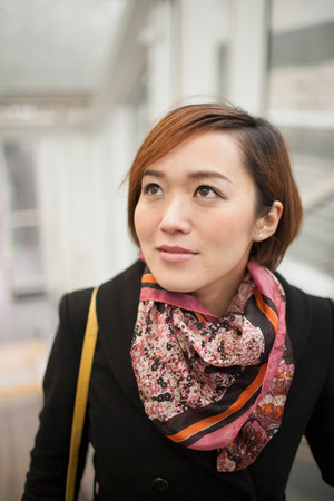 Young brunette woman wearing patterned scarf LANG_EVOIMAGES