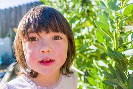 Girl in fava bean garden