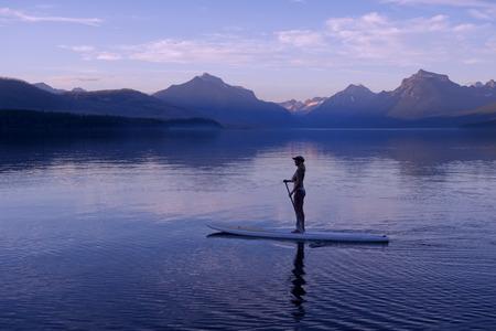 Woman on canoe,Lake McDonald,Glacier National Park,Montana,USA LANG_EVOIMAGES