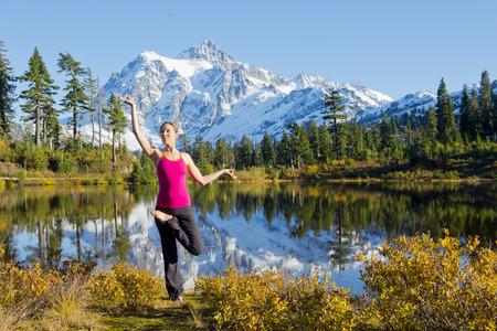 Woman doing yoga in mountain scene,Bellingham,Washington,USA