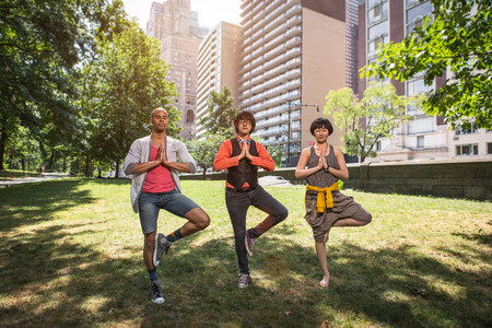 chillout: Three young people doing yoga in park