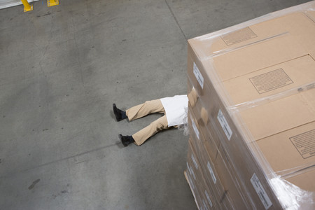 new age: Man lying on floor with cardboard boxes in warehouse