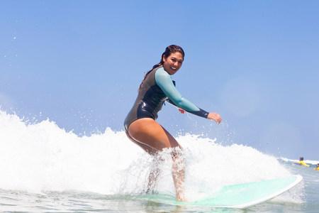 Young woman surfing,Hermosa Beach,California,USA