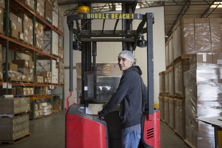 truck: Factory worker with fork lift in warehouse LANG_EVOIMAGES