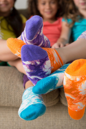 footsie: Girls wearing brightly coloured socks LANG_EVOIMAGES