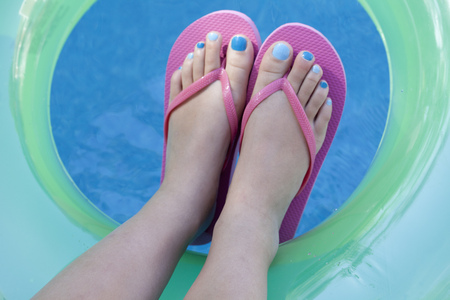 Overhead view of feet with colored nails LANG_EVOIMAGES