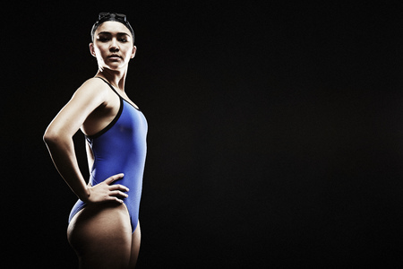 athleticism: Young woman wearing blue swimsuit