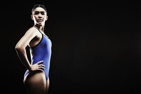 bi: Young woman wearing blue swimsuit