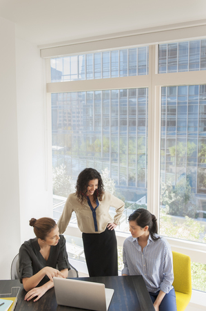 organised: Young businesswomen and client meeting in office LANG_EVOIMAGES