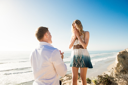 disbelief: Young man proposing to girlfriend by sea, Torrey Pines, San Diego, California, USA