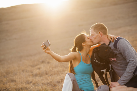 Kissing couple with dog