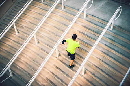 athleticism: Mature male runner training on steps