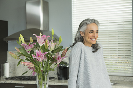 grays: Woman by lily arrangement