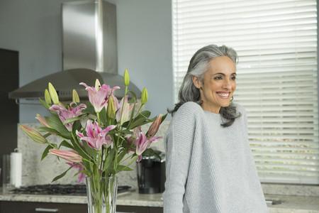 tallness: Woman by lily arrangement