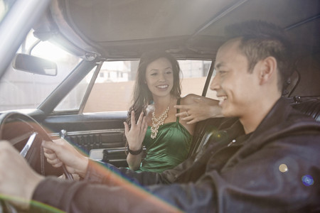 go inside: Happy couple chatting whilst driving in car